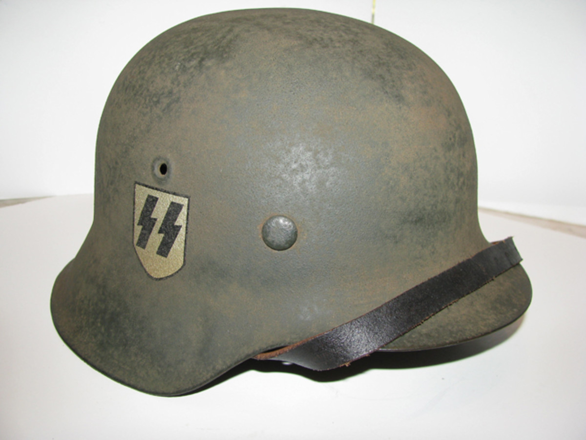 Siegrune (double lightning bolt) decals were affixed to many Waffen SS combat helmets. Mark Pulaski Collection