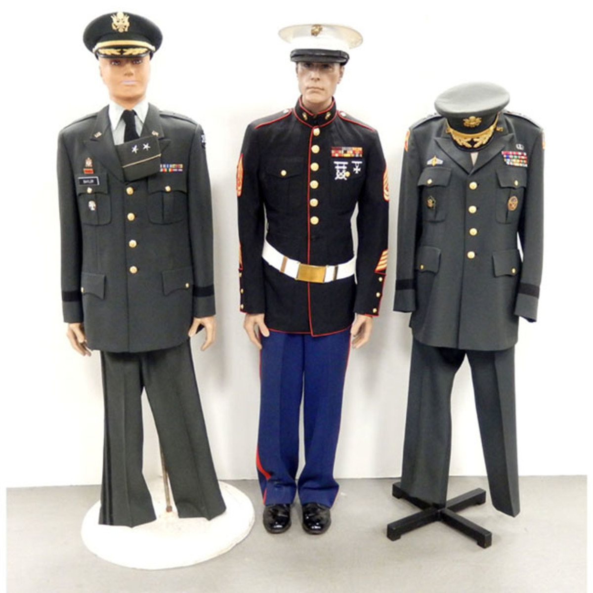 U.S. military uniforms, two for Army major generals; one for a WWII Marine gunnery sergeant