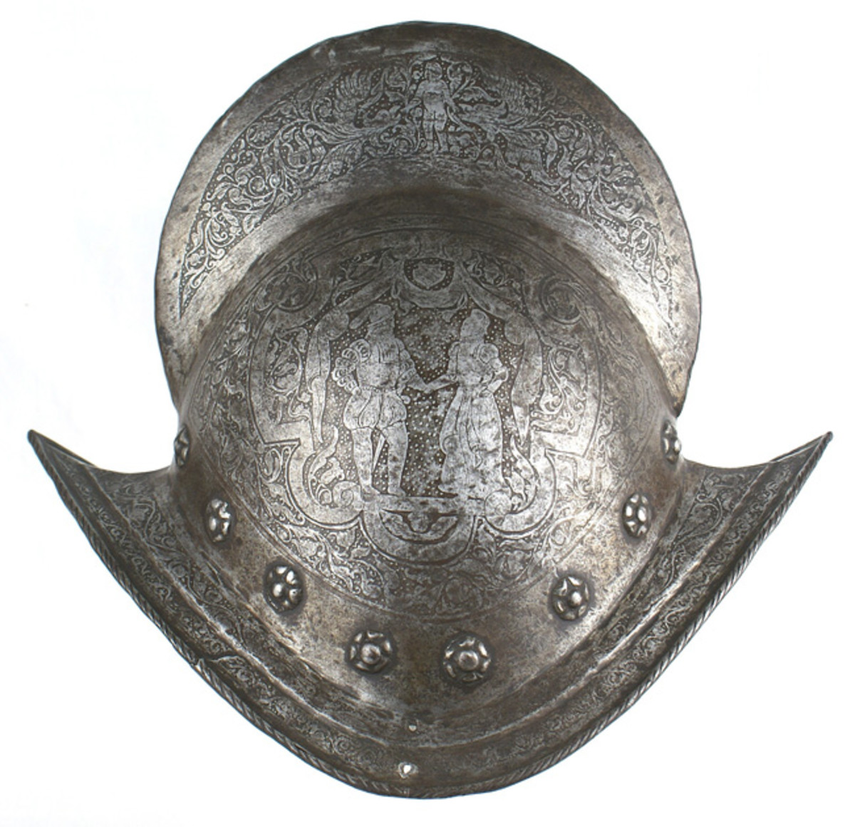 Rare, 16th century Spanish or Italian combed morion, or tall dome-shaped infantry helmet, profusely etched with floral designs ($7,675).