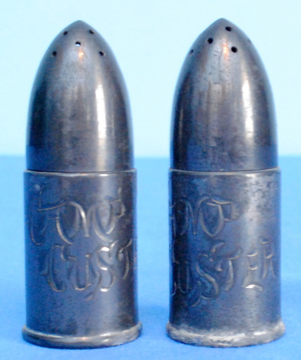 From Camp Custer in Michigan comes this nice salt and pepper shaker combination disguised as artillery shells. Once again, most large training sites had such sets for sale in their camp stores and it would make a challenging but possible collection to obtain a set from each camp.