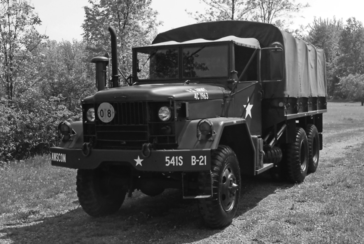"Chad Waybright's truck was originally assigned to a US Army engineer company in North Carolina in 1954. It had the factory-assigned number, ""4C1963."" The Deuce was refurbished in 1971 as an M35A1. It was refurbished again by the US Army as an M35A2 in 1991. The diesel engine was upgraded and the deuce was painted CARC camo.Chad and a friend prepared everything they could remove, including all 11 wheels. A local trucking repairing facility painted everything, this time using 24087 OD Gillespie paint to bring it back to its 1971 appearance.The present markings reflect the unit to which Chad was assigned in the early 1960s: 541st Signal Company (SPT), AWSCOM (Advanced Weapons Support Command), Pirmasens, Germany."