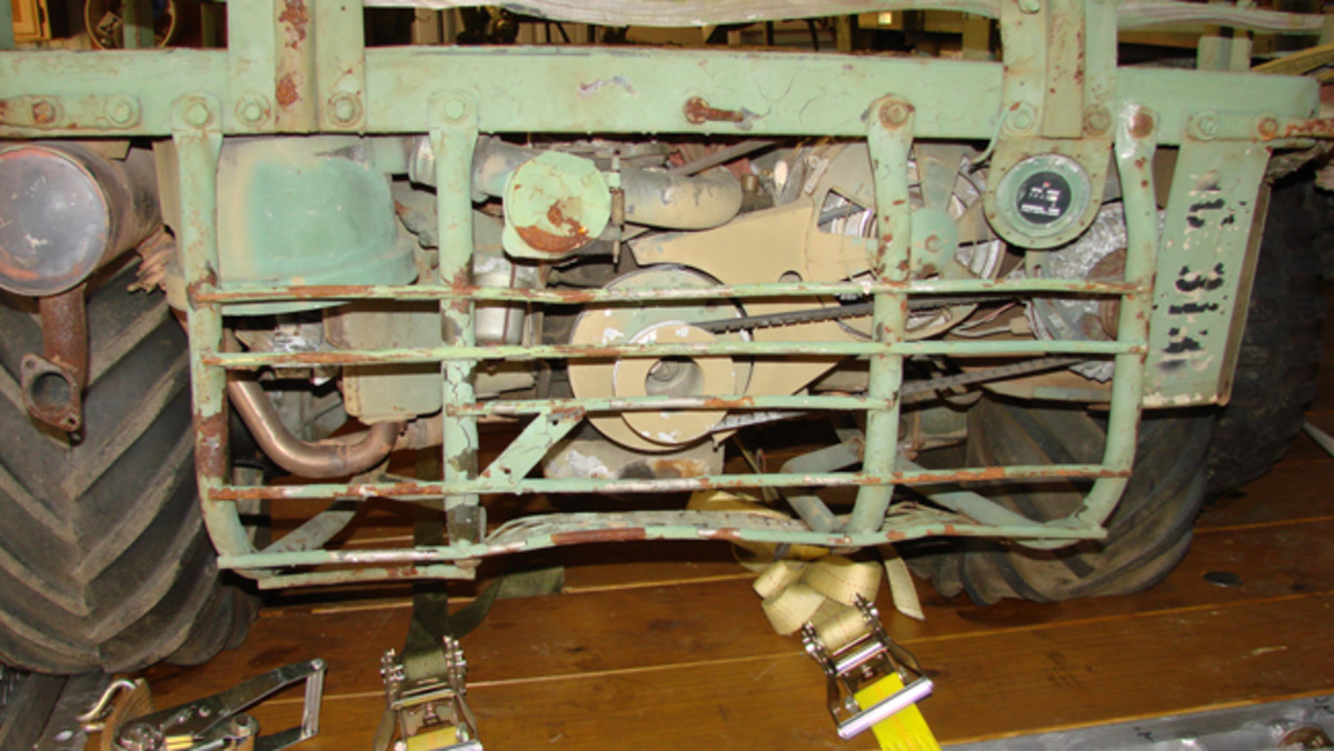 The restoration was two-fold: First, find a mule originally built as a TOW carrier, and then restore it to original condition. Here is the rear view of the engine, note the hour meter and original alternator set up with the double pulley.