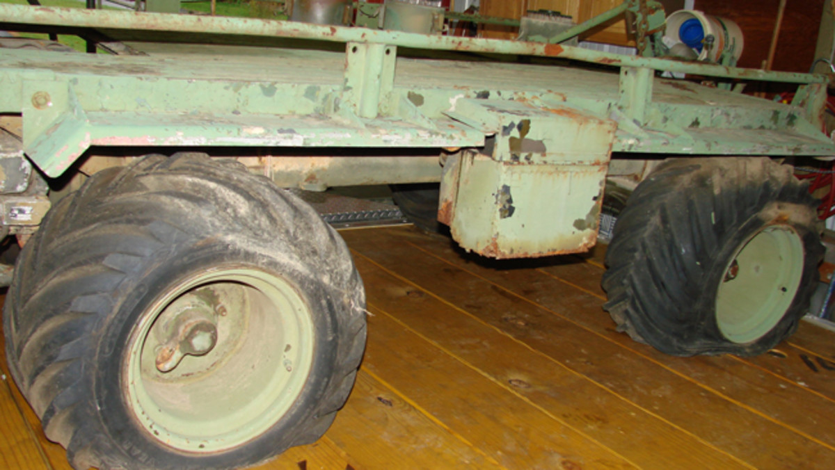 The four Flat tires and the battery box with the rusted out bottom can be seen in this photograph.