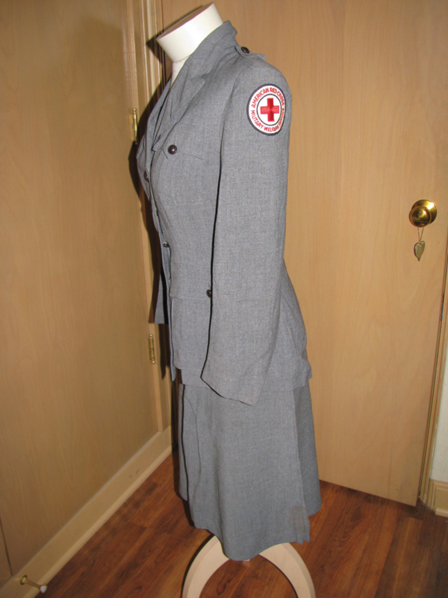 Her standard gray summer Red Cross uniform bears the ARC military service sleeve patch.