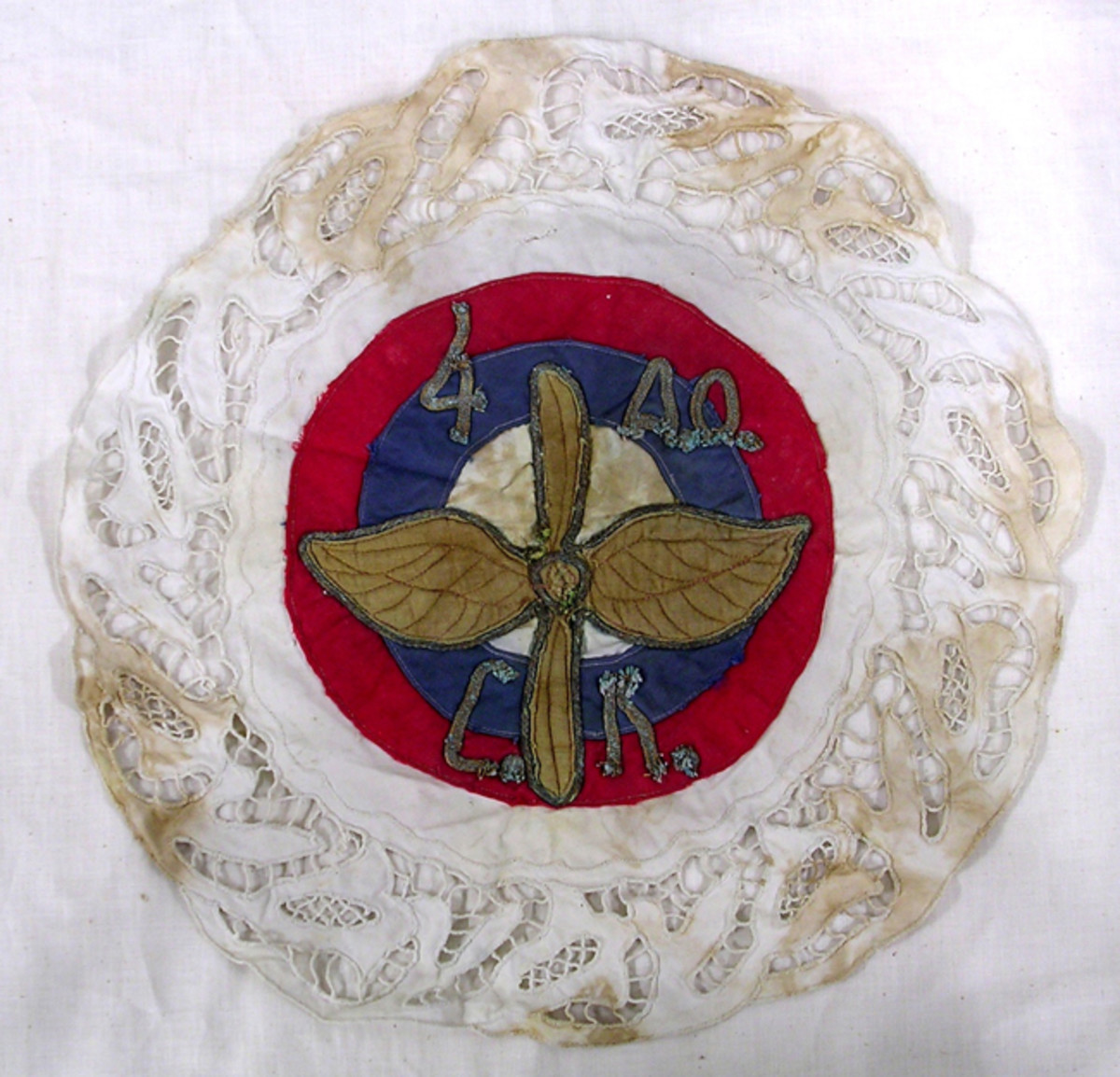 Imperial Russian cloth doily with lace edging with center decoration of Russian air service insignia of winged propeller and lettering for Imperial 4th Air Group.