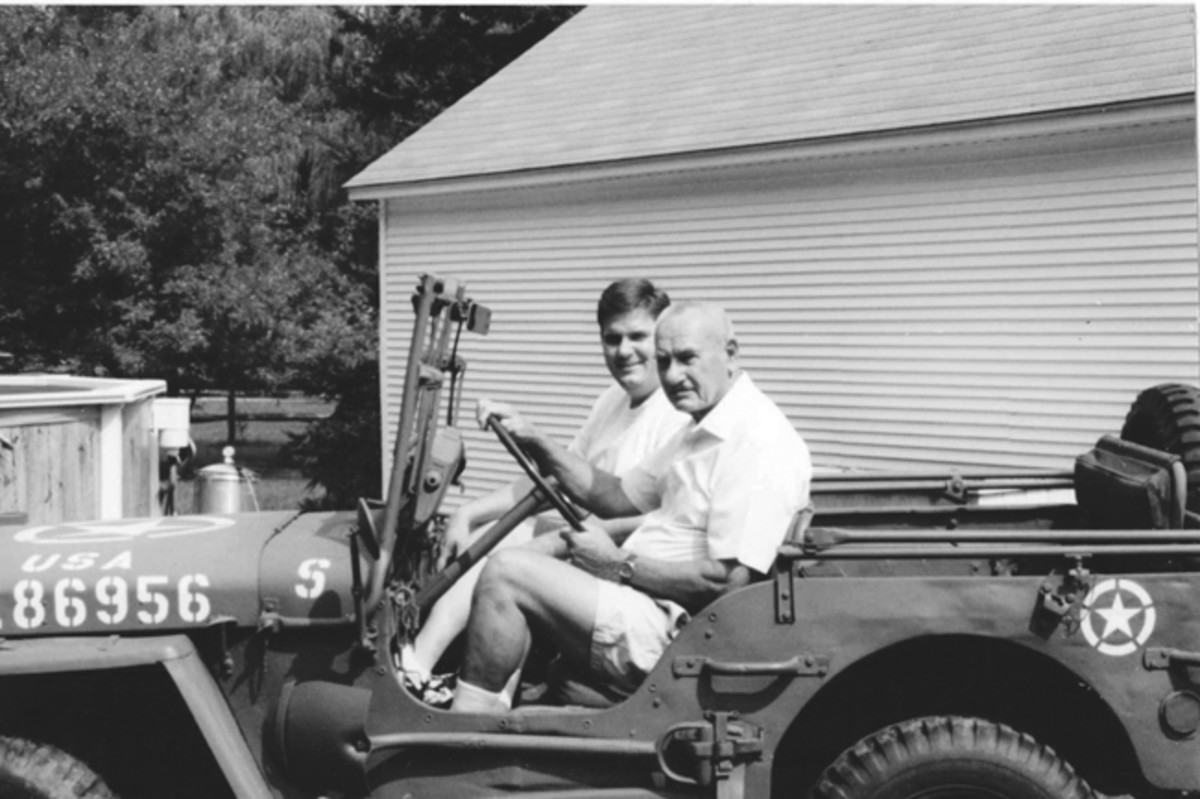 After Michael got his driver's license, he bought the family Jeep from his Dad for $75. In the years since the purchase, Michael has driven the Jeep thousands of miles and participated with it in countless parades, displays, and reenactments. This photo from 2000 recreated the Father-Son scene from thirty years earlier.