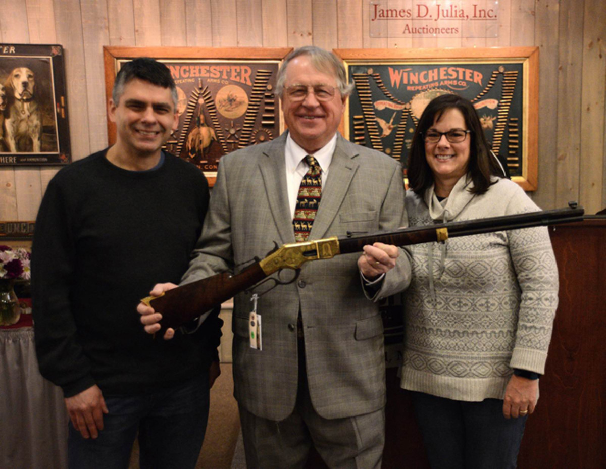 After the auction, Jim, together with Larry Bentley and Barbara Stoken, Ray Bentley's two children, pose with the star of Ray's first group of Winchesters.