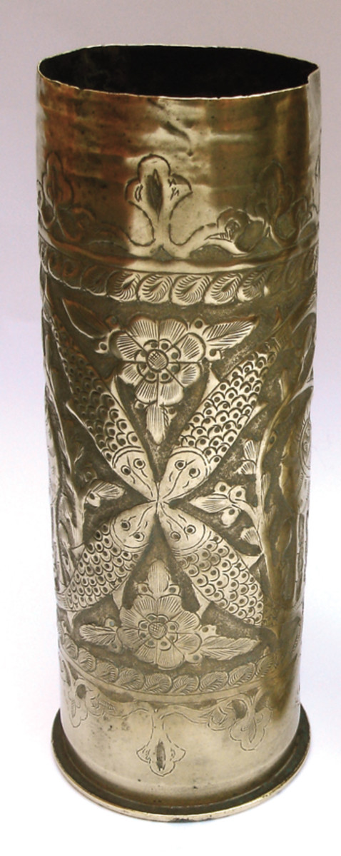 Vase engraved with a stork and fish. World War I trench art made from artillery shell.Claire Luisi, www.trenchartcollection.com