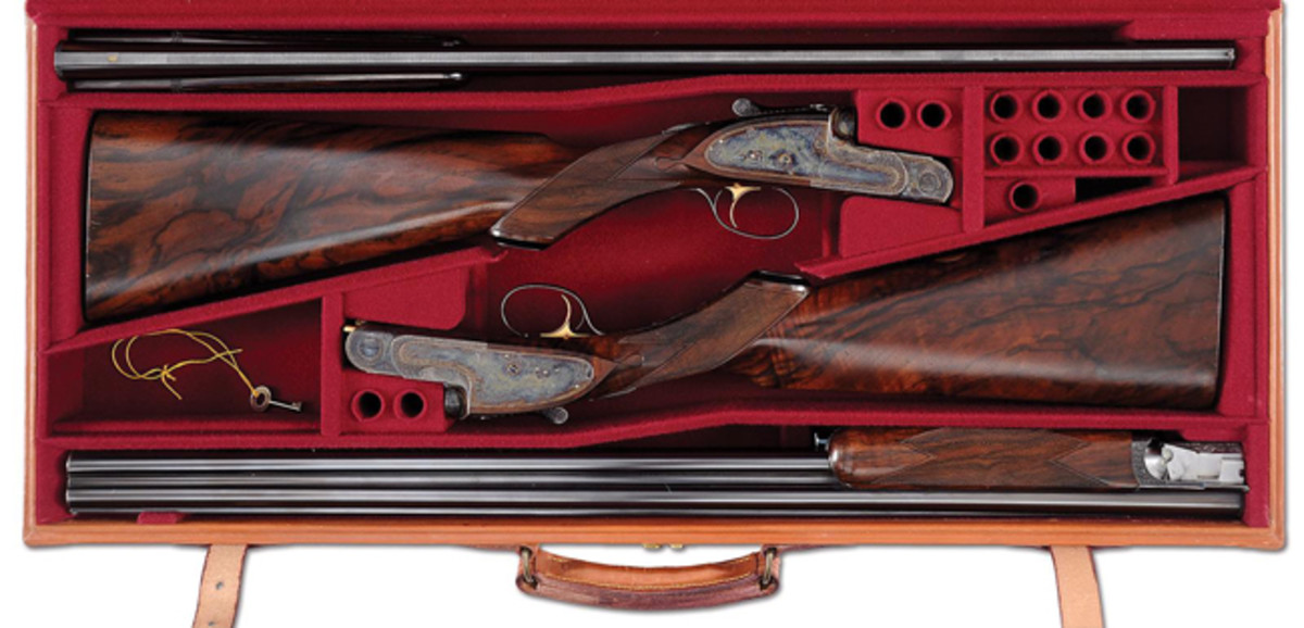 Cased pair of Woodward 20 gauge over-under game shotguns, the very first pair of Woodwards made after being purchased by Purdey