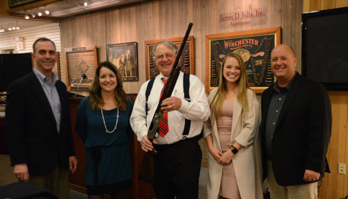Jim is an avid bird hunter and Dan Morphy, together with part of his team, decided to present Jim with a special going away present of a beautiful new Benelli shotgun. Here Dan Morphy to the right, together with Stephanie, Dana (CFO of the company), and Craig to the far left (CEO of the company).