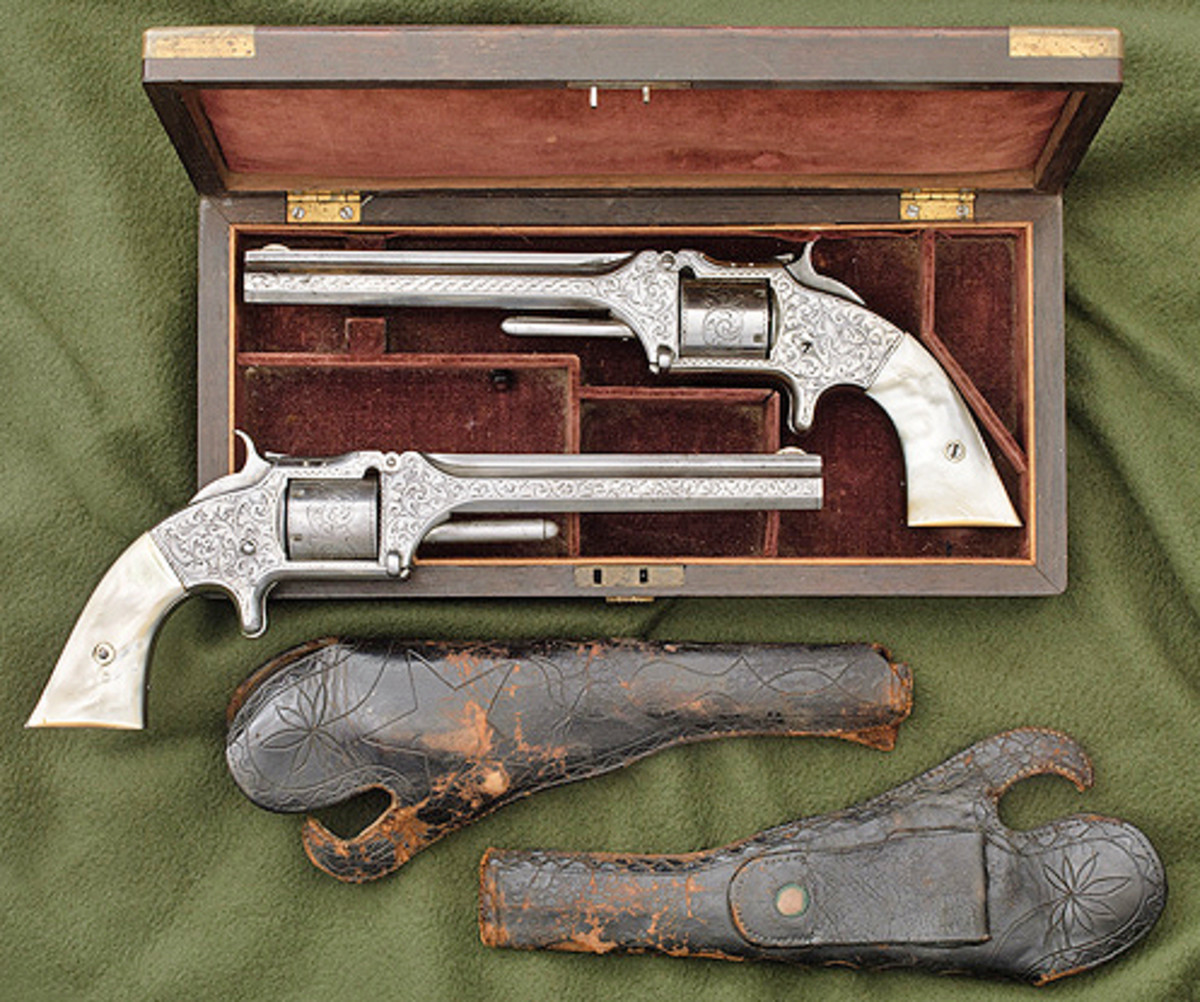 Pair of Nimschke-Style Engraved Smith & Wesson Model No.2 Revolvers Inscribed to D.B. Dyer. Price Realized: $28,750.