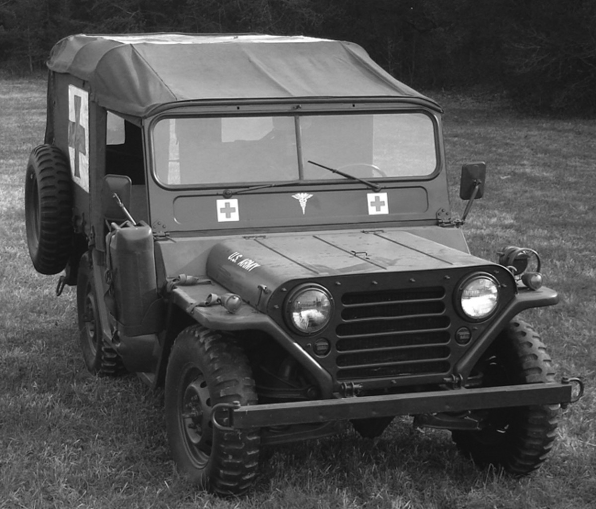 Although technically not a jeep except by nickname, the ambulance variant of the M151 MUTT, is the M718. As with the M606 and Mahindra units, the M718's body was extended in the rear while retaining the standard wheelbase, and stretcher racks installed. Note the original spare wheel mount still in place despite the body extension.