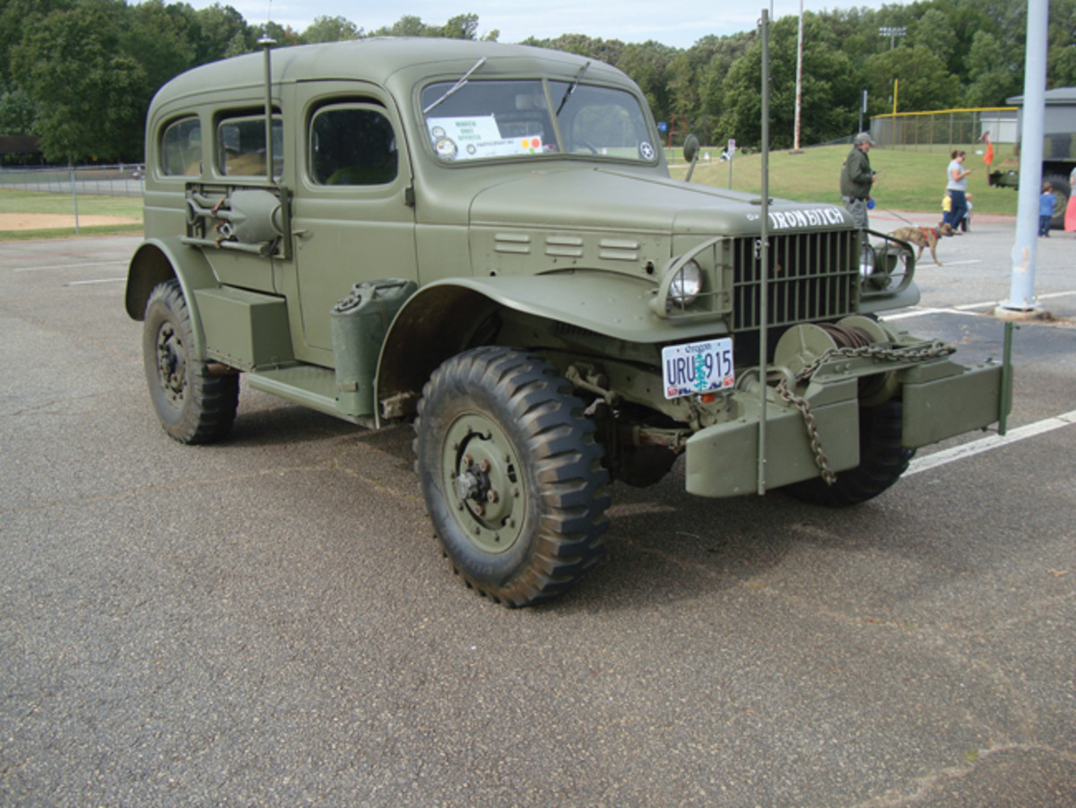 Mark and Gunnar Sigrist's Dodge WC53 with added mu2 winch, turn signals, FRS/GMRS radio antenna, lockout hubs, and with post-war engine and master cylinder. Walking the dog in the background is 2015 Convoy Commander Terry Shelswell — even he has other duties as assigned! 12,000 miles in the past 15 years.