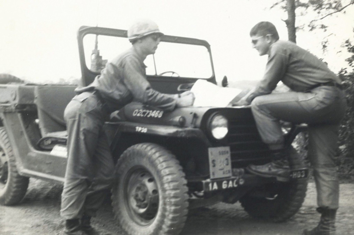 """Jeff Latz sent this photo along with the explanation, """" Lieutenants Latz and Simmons, S-3 liaison officers, First Squadron, Sixth Armored Cavalry Regiment, look at maps on the hood of an M151 during training exercises at Fort Meade, Md., 1970-'71."""""""