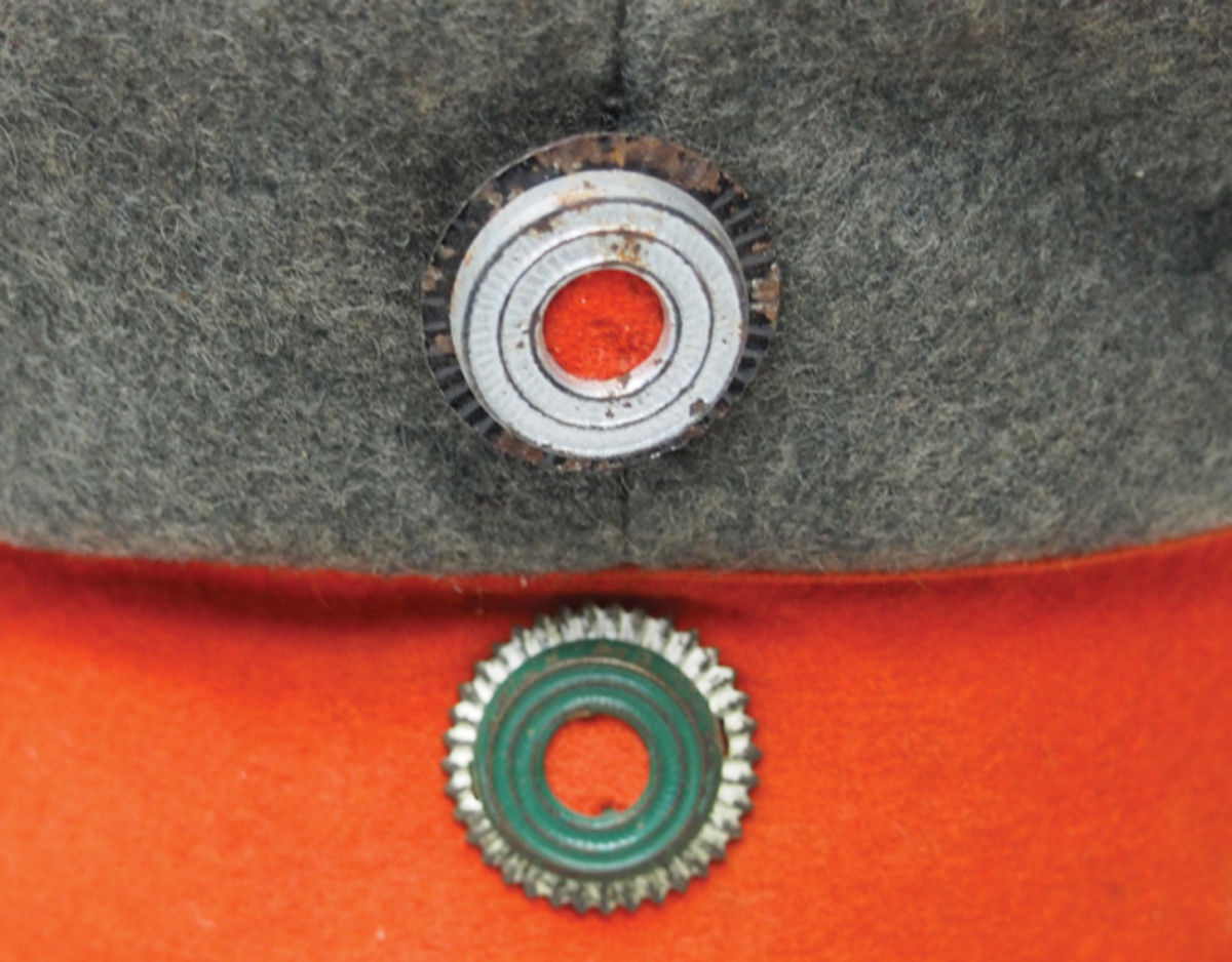 "In Imperial Germany officers and NCOs wore two-piece ""kokarden"" – with the Reich's cockade worn above the state cockade – in this a Saxon on a visor/peaked cap or ""Schirmmütze""."