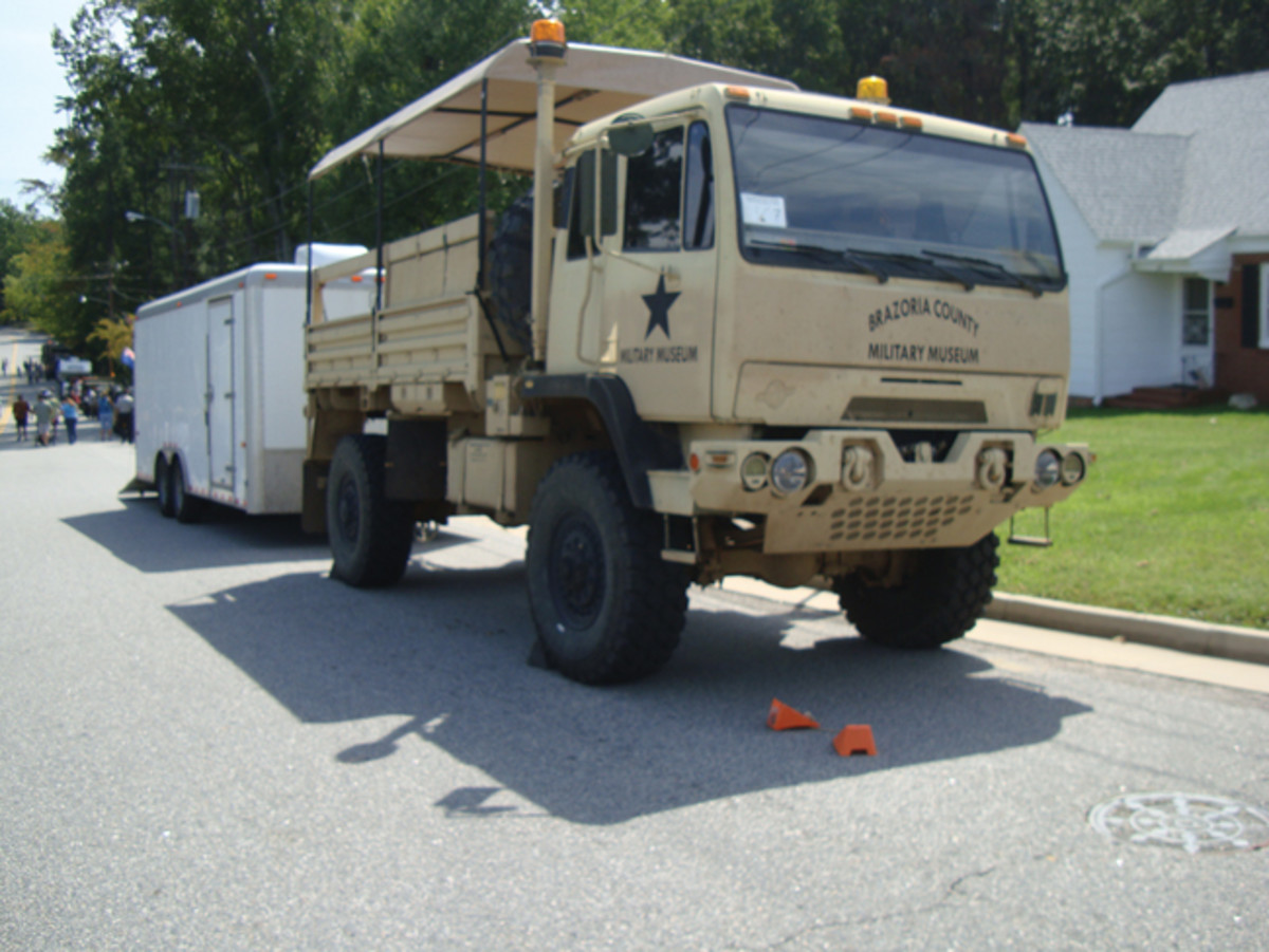 Justin Wehring's M1078A1 towing a box trailer with living quarters and supplies in support of Bill Kreider and Dan Tuohy's Harley-Davidson WLAs on the 2015 Bankhead Convoy. Justin made many unseen user-friendly modifications including axles from an MRAP, air conditioner, seats and more – talk to Justin!