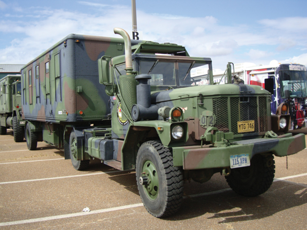 Henry Pacha's modified M35A3 tows an M146 trailer converted to living quarters, including a fireplace! The cargo truck, now a tractor, had axle removed, 5th wheel and air conditioner added, modified bumper, and additional fuel tank, generator and tool boxes added to the frame where the other axle was (plus a vice and siren). Henry has driven this combination more than 30,000 miles in the past 6 years