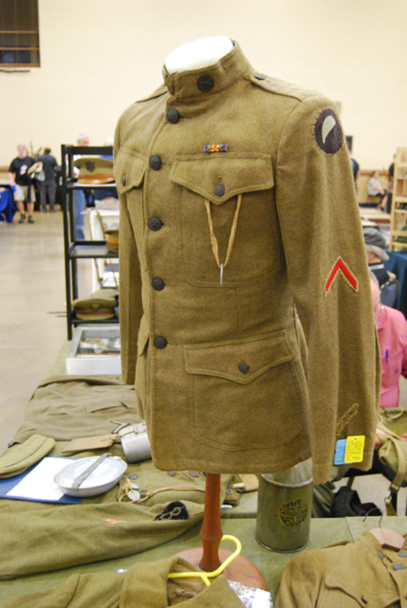 "A uniform to the 93rd Infantry Division, which was a ""colored"" segregated unit of the United States Army during the First World War. It was never fully formed, except for the infantry units that included the 369th Infantry Regiment (""The Harlem Hellfighters"") and the 370th Infantry Regiment (""The Black Devils""), which fought under French command. The unit earned the nickname ""Blue Helmets"" as a result as the troops were issued blue French Adrian helmets, and this became the shoulder patch!"