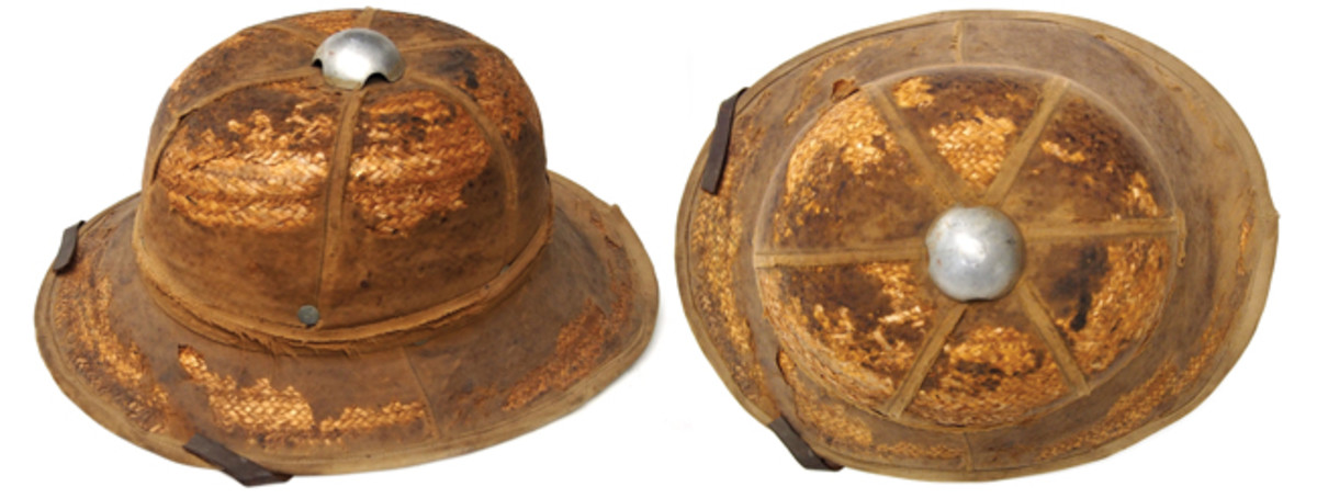 "A very worn German Afrika Korp ""First Pattern"" tropical helmet – the extensive wear and rotting to the outer canvas covering has exposed the straw shell. This weaving, even when done by specialized machinery, was likely a time consuming process."
