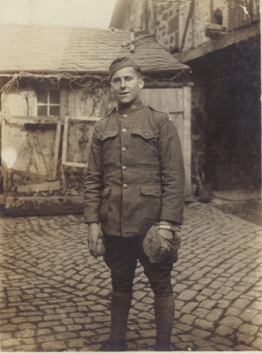 After the signing of the Armistice, a large number of Doughboys found themselves occupying the German Rhineland. In this photo, Albert Pittson, an engineer in the 3rd Division, poses with his baseball mitt and ball in the German town of Ochtendung in April 1919.