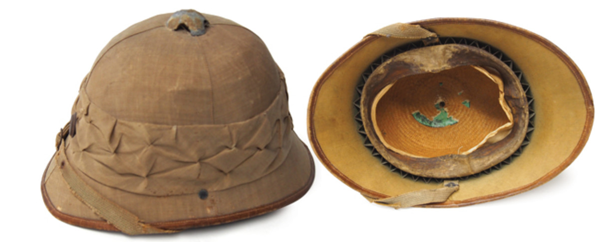 This World War I Austrian helmet has the same basic shape of the popular colonial pattern helmets of the era but this helmet has a straw wicker body. These helmets were used by the Austro-Hungarian forces in the Balkans and on the Palestine Front.