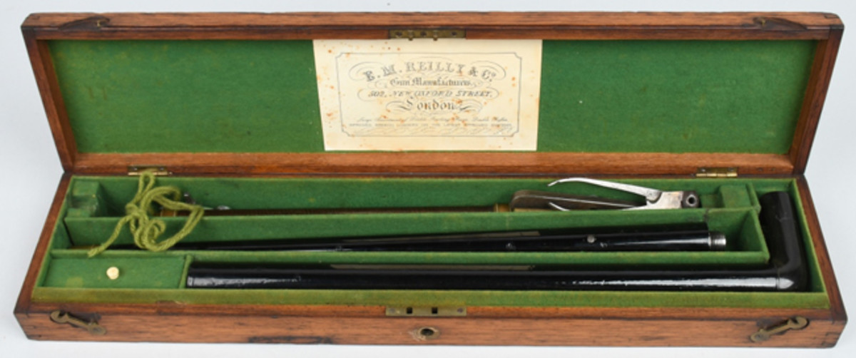 Circa-1850s E.M. Reilly (London) .32 caliber air-powered cane gun in original oak partitioned case with dealer's trade label inside lid. Shoots lead balls.