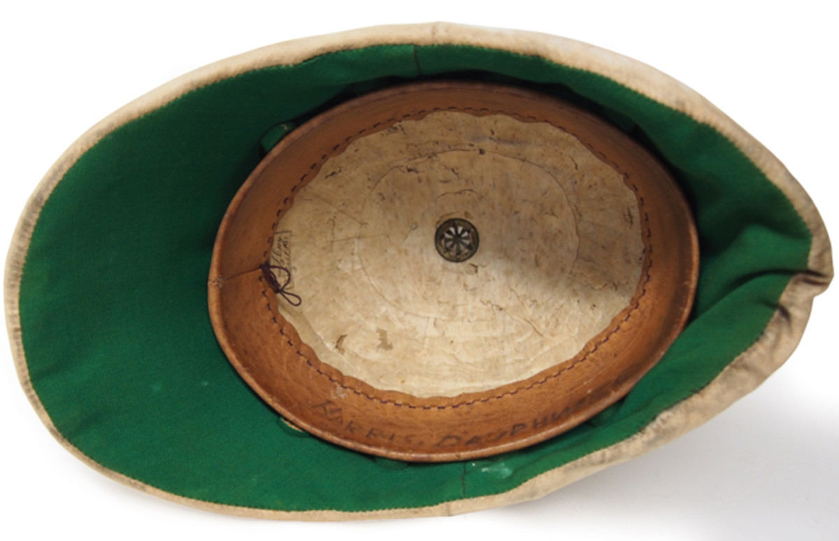 "This interior shot of a 19th century ""colonial pattern"" sun helmet shows the exposed pith. It is the white spongy material. These helmets typically featured a straw or wicker frame that helped keep the sola pith in place."