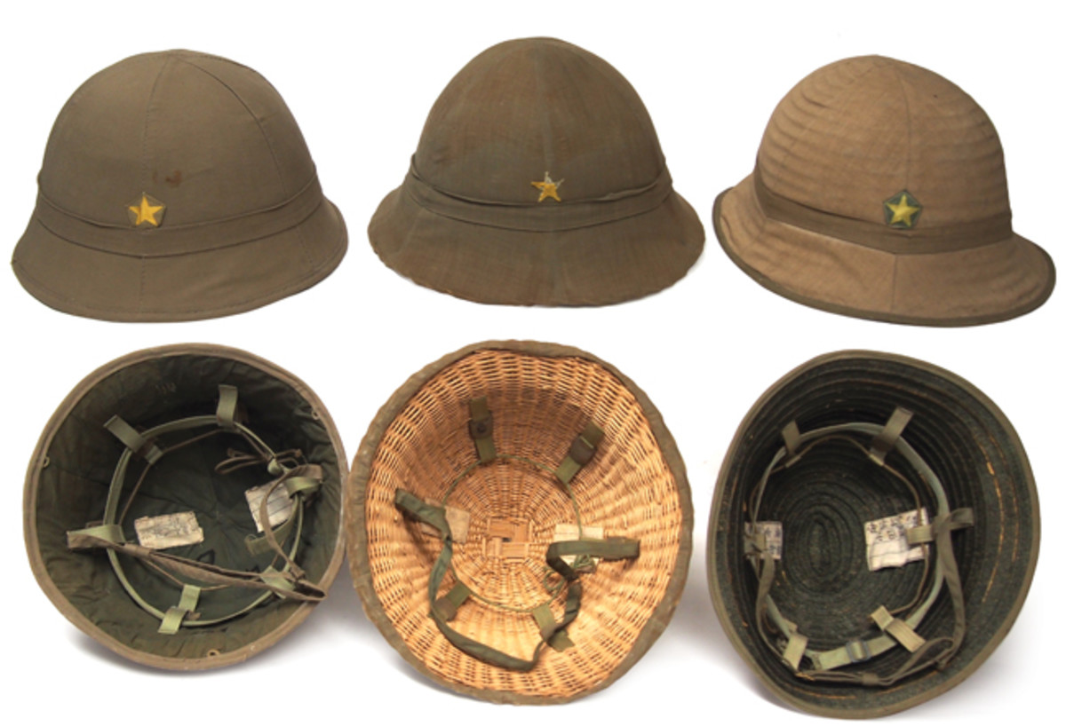 "The evolution of Japanese helmets is shown in these three helmets – the helmet on the far left is made of pressed bamboo fiber and features both a covered exterior and interior, while the middle helmet shows the move to a wicker/straw body construction where the interior of the helmet is exposed. Finally the Japanese helmets featured no real body construction but relied instead on the Sanda Tape cloth that created more of a ""sun hat"" than true helmet."