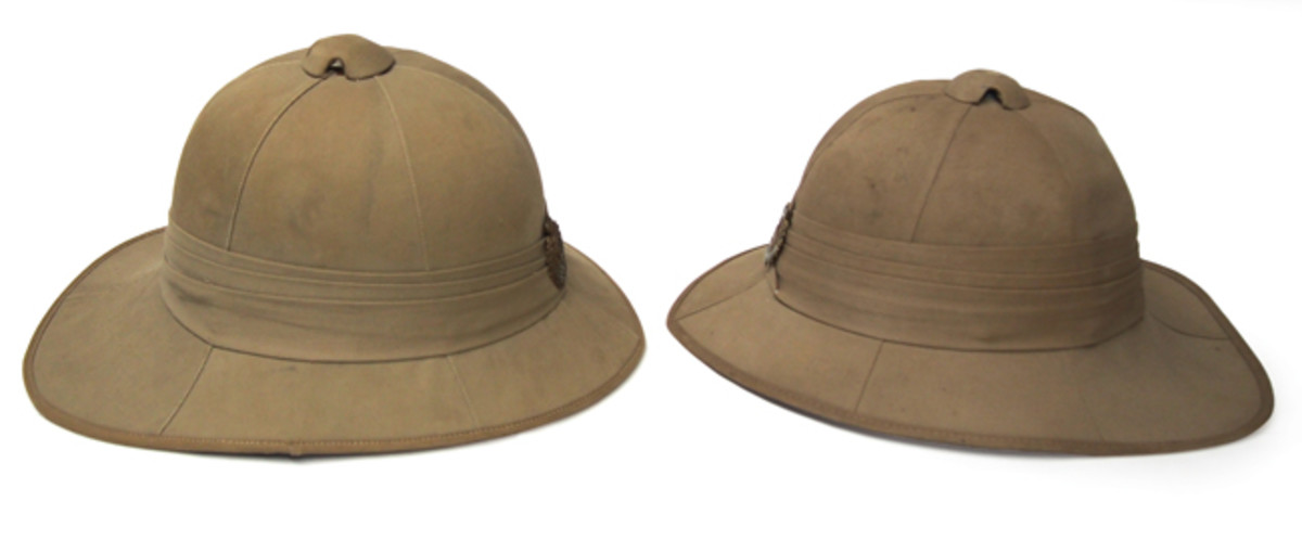 This exterior shot shows a cork Wolseley pattern helmet (left) next to a felt helmet. The only tell-tale sign is that the rear brim is unable to support the weight of the helmet body and tends to sag when both are sitting on a flat surface.