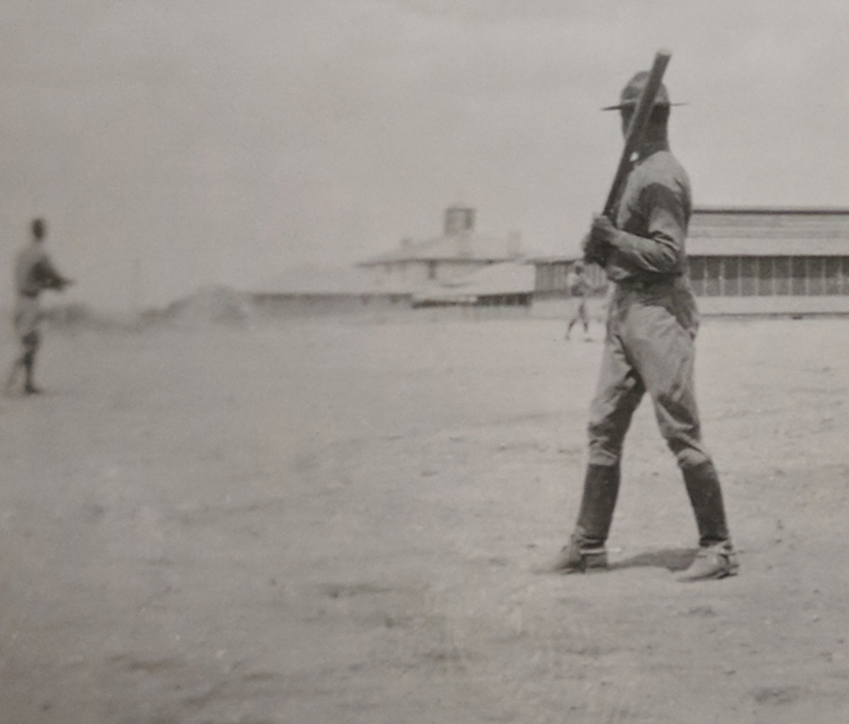 One of the few benefits of serving at posts in Texas and the Southwest was the abundance of open space to play baseball. In this photograph, left-hand hitting Lieutenant Houghten of the 13th Cavalry Regiment takes his turn at bat. It is interesting to note that the lieutenant is still wearing his spurs as he waits for the pitch. Courtesy the Robert Goodwin Collection