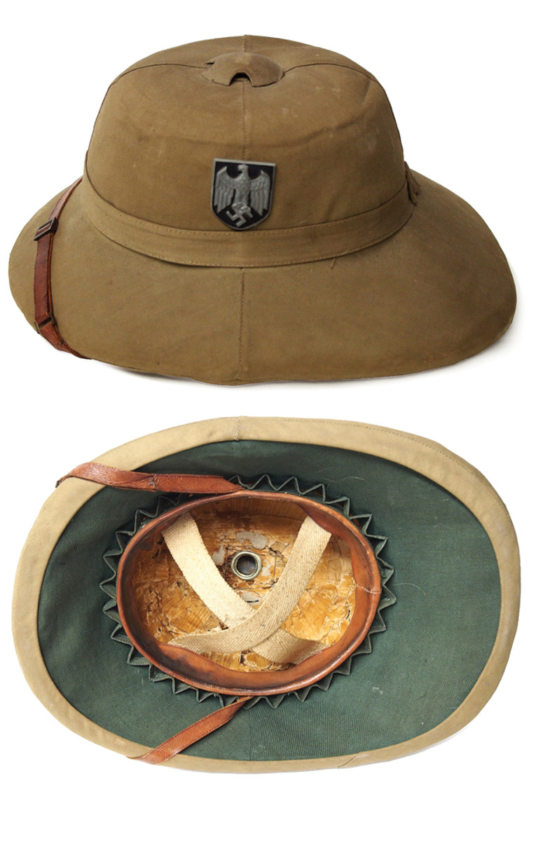 "A ""German Pith Helmet"" – this is actually a British made Khaki Sola Pith Hat (KSPH) that was likely used during the defense of Greece or Crete and captured by the Germans. These helmets proved popular with the Germans that served garrison duty in the Greek isles. It could also be that these soldiers weren't given much of a choice!"