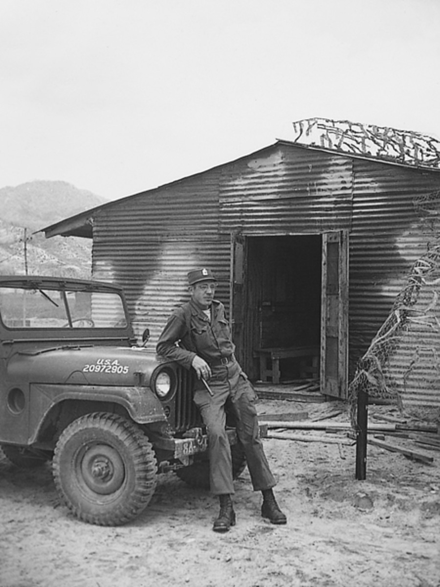 Sgt. Schmalengerger, a friend of Schramm's, leaning on an M38A1, Korea, 1951.