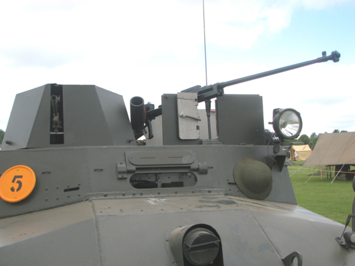 Detail of weaponry carried on the Morris LRC. To the left is the muzzle of the Bren Gun protruding from turret and to the right is the hefty Boys anti-tank rifle. In the center can be seen the smoke grenade launcher.