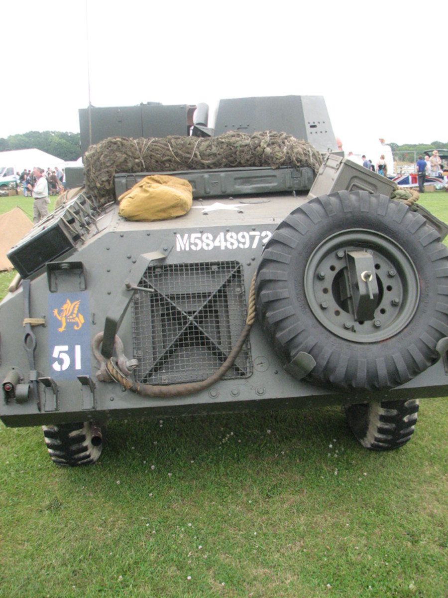"Rear view of Morris LRC showing radiator grille covering and spare wheel stowage. The white star on the engine deck is the standard Allied insignia for vehicles in the Normandy campaign. The winged emblem above the ""51"" is a 'Wyvern' the insignia of the 43rd (Wessex) Division."
