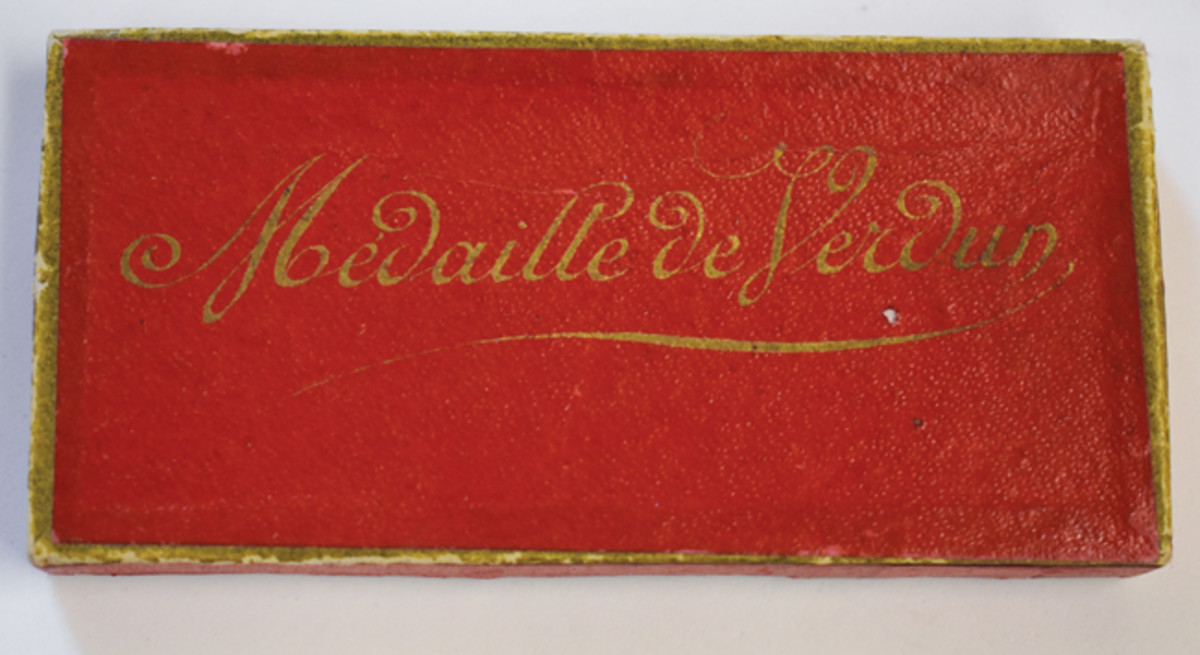 Most of the wearable Vernier medals were awarded within red presentation boxes.