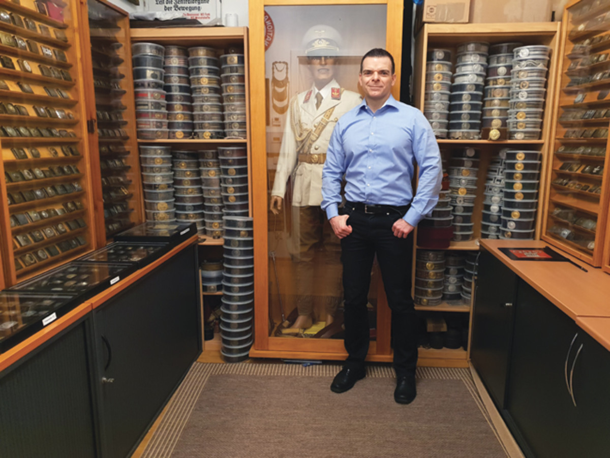 Thomas W. with his German buckle and brocade collection, considered the largest in the world.
