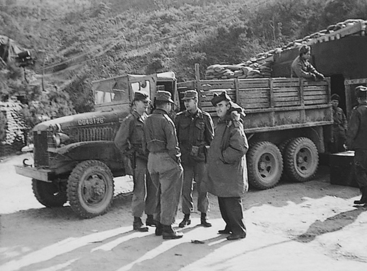 Unknown group of U.S. soldiers unloading a CCKW, Korea, 1952.