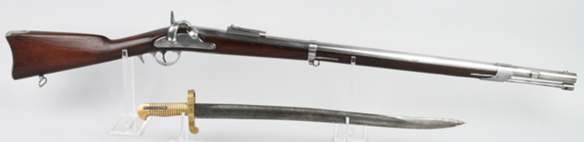 Near-mint unissued Whitney Model 1861 US Navy rifle, barrel dated 1863, .69 caliber, large eagle-and-flag motif on lock. Bayonet made by Collins & Co.