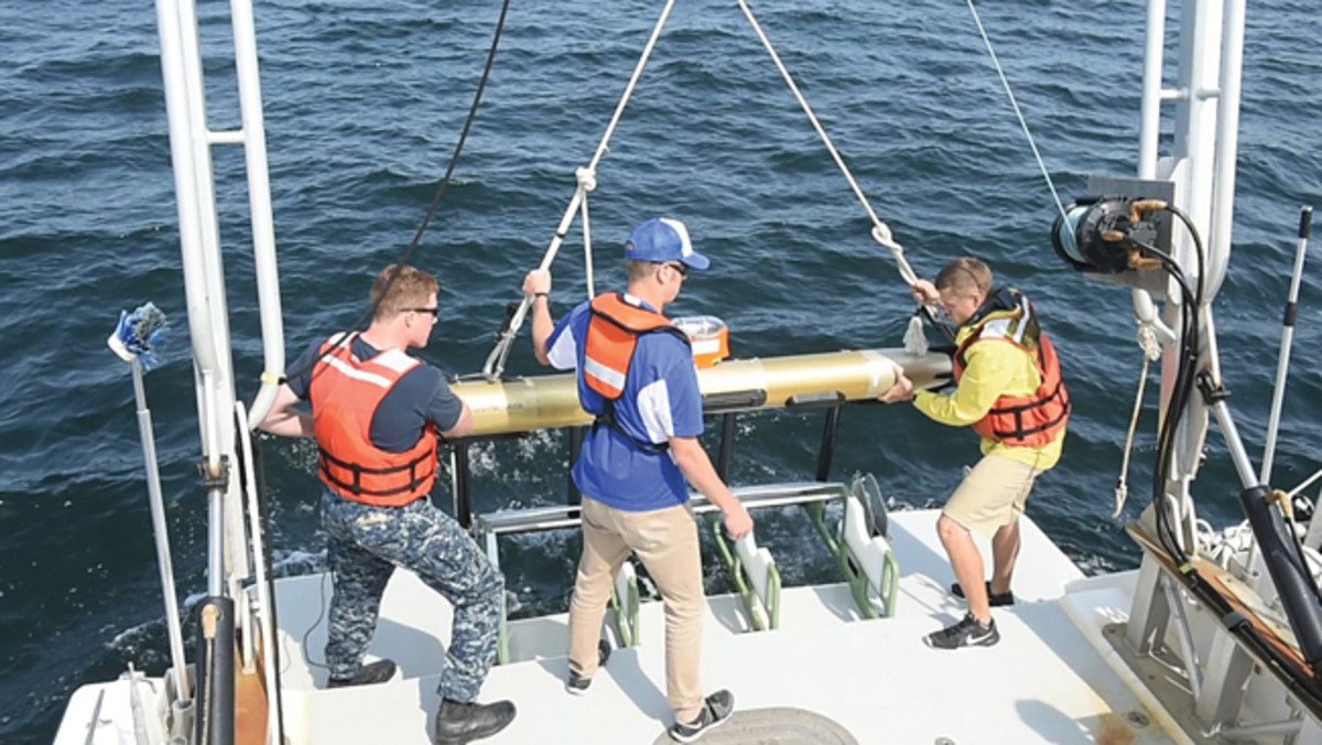ATLANTIC OCEAN (Sept. 11, 2017) – U.S. Naval Academy (USNA) Midshipman 1st Class Nolan Brandon, Ken Haulsee, a graduate student at the University of Delaware, and Peter Barron, a laboratory technician at the University of Delaware, left to right, lower an autonomous underwater vehicle into the water in order to take sonar data on the wreck of the World War I-era armored cruiser USS San Diego (ACR 6), Sept. 11. Members from the Naval History and Heritage Command, Naval Surface Warfare Center Carderock Division, the University of Delaware, the Office of Naval Intelligence, and a USNA midshipman started surveying the shipwreck to gain scientific insight, historical clarity, and in preparation for the 100th commemoration of the vessel's sinking. The project started with a side-scan sonar and bathometric survey. San Diego was believed to have been sunk off the coast of Long Island in 1918 by a German submarine. U.S. Navy photo by Mass Communication Specialist 1st Class Eric Lockwood/Released