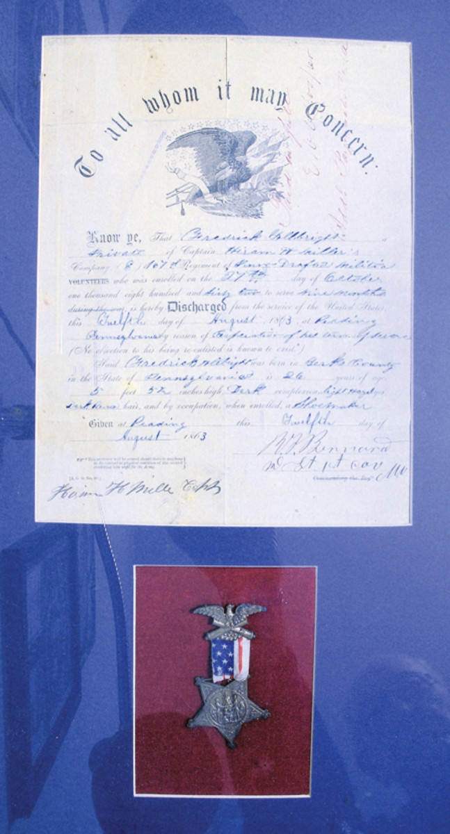1863 Discharge of Fredrick Albright with his GAR membershipmedal. If I hadn't taken the time to follow up on leads, I would never have been able to reunite this discharge with the photo of my Grandfather Albright.