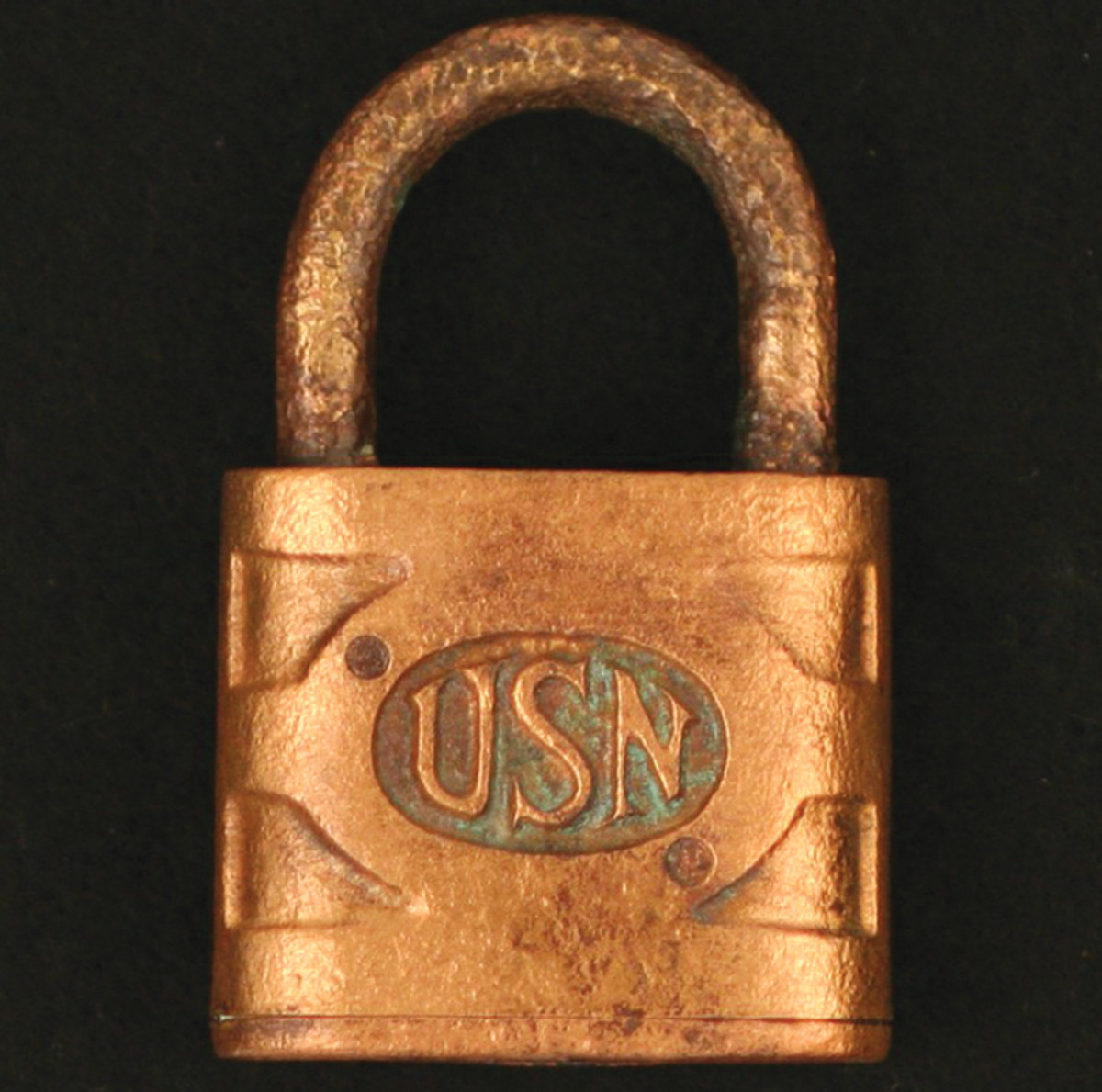 "This padlock was recovered from WWI-era armored cruiser, USS San Diego. The obverse side has ""USN"" cast into it and the reverse side not shown are cast the letters ""ILCO."""