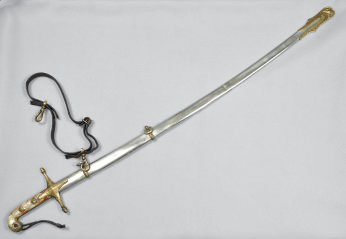 A USMC Marmeluke Officer's Sword from WWI-era ship USS San Diego. This particular type of sword, Marmeluke, was adopted by the United States Marine Corps in the 19th century and usually carried as a dress sword by officers. Accession no. 2010-75-17