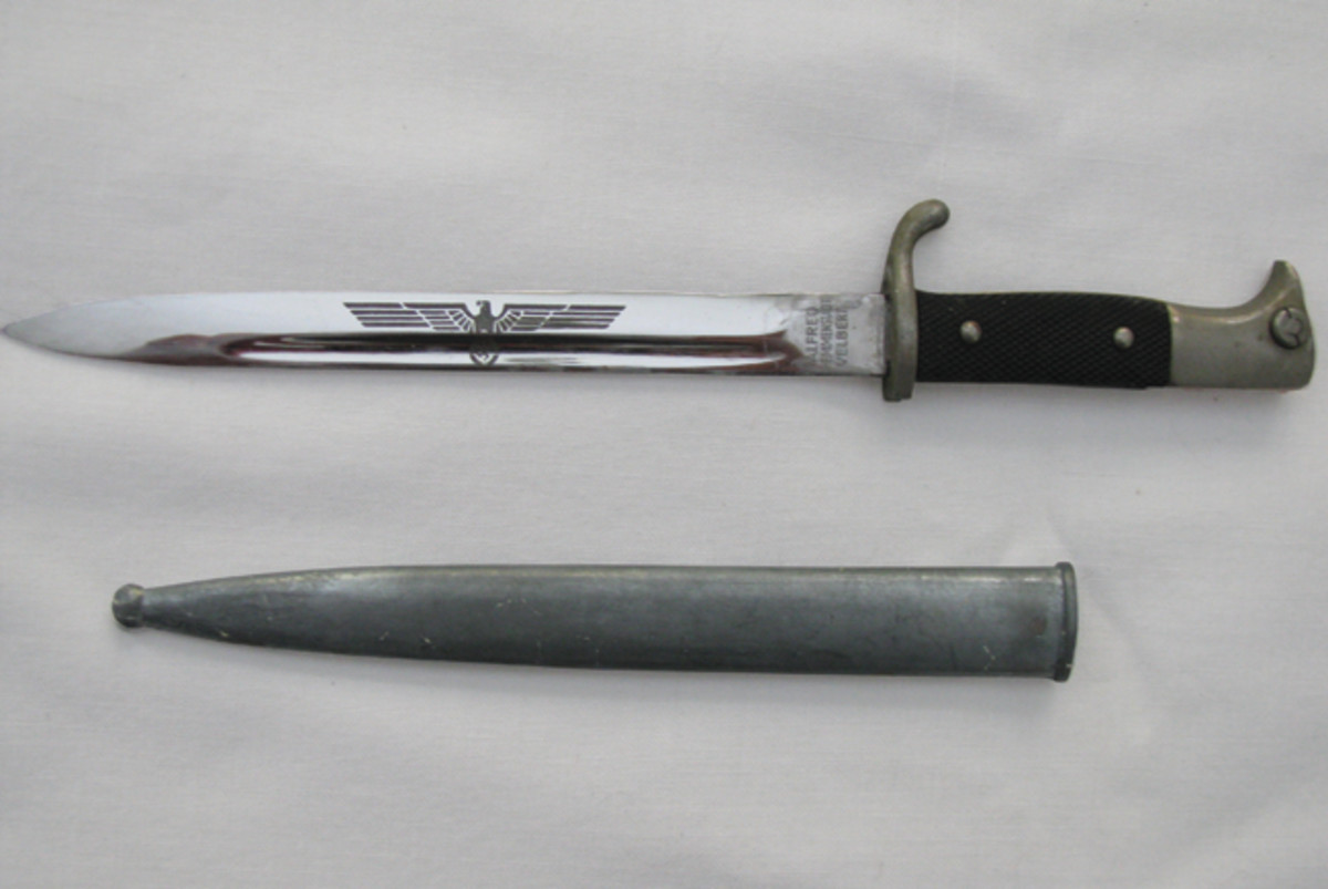 This miniature Third Reich dress bayonet has an etched blade with a national eagle and the name of the tool and die company that had it made as a promotional giveaway.