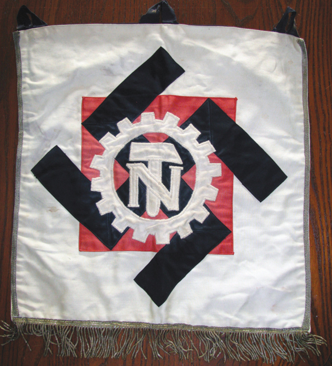 TENO trumpet banners and flags shared the same white, red, and black design.