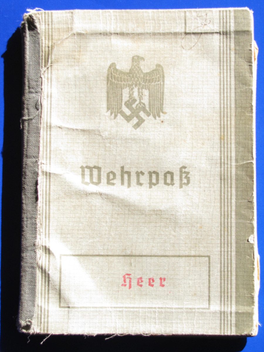 "The first version Wehrpass cover eagle had folded wings and is marked ""Heer"" (army). This one belonged to Ludwig Tung."