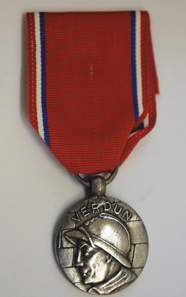 "Referred to as the ""Anonymous Medal,"" this silver version has no maker's mark."