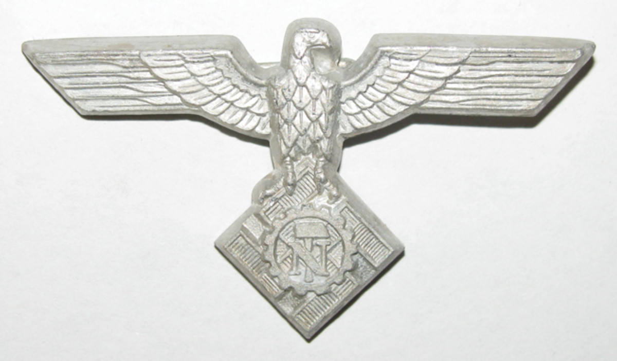 "The TENO outstretched cap eagle was perched on a squared swastika, hammer, and ""N."""