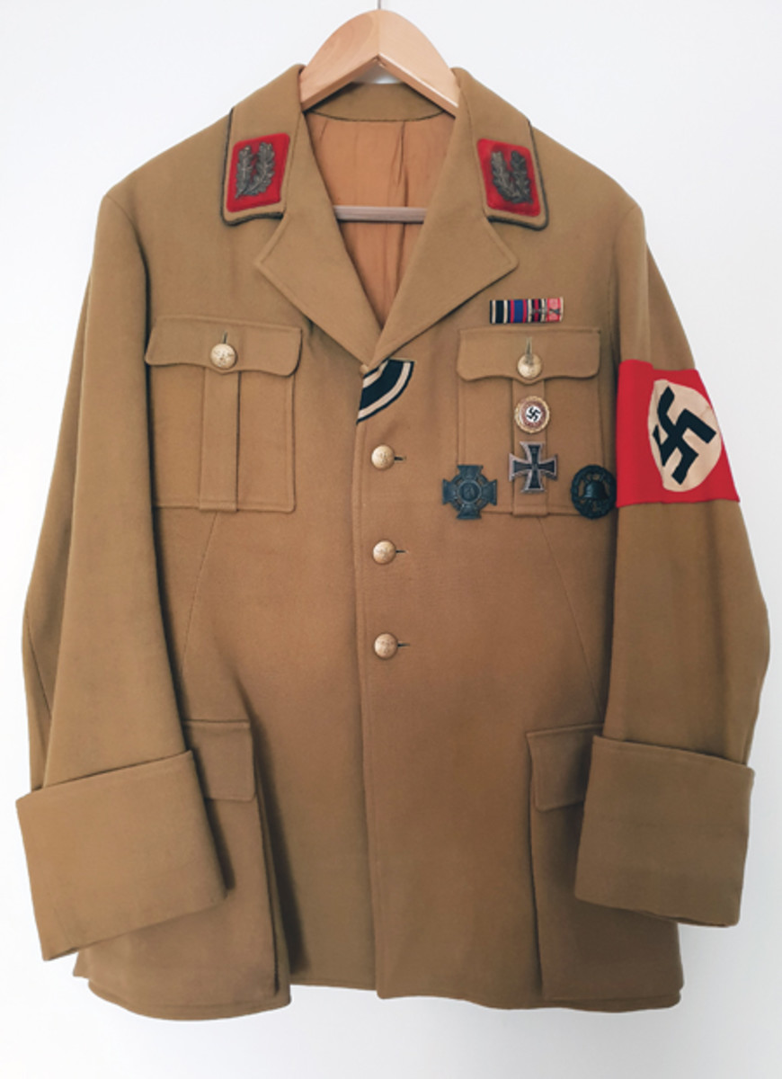 In addition to buckles, Thomas W. collects a wide range of rare Third Reich uniforms, pennants, flags, desk sets, porcelain, etc. This tunic, once belonging to NSDAP-Gauleiter Joachim Eggeling, is one of his favorites.