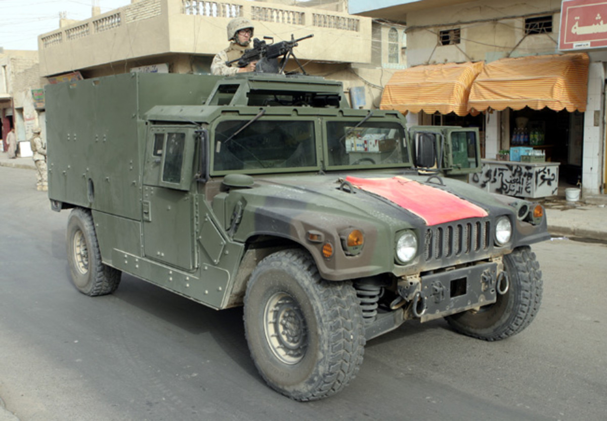 By necessity, in Iraq the HMMWV has been fitted with ever-increasing amounts of armor, in an array of configurations. An example of this is the Marine Corps MAK HMMWV (Marine Armor Kit equipped High Mobility Multi-Wheeled Vehicle), an example of which is seen here patrolling downtown Fallujah. USMC