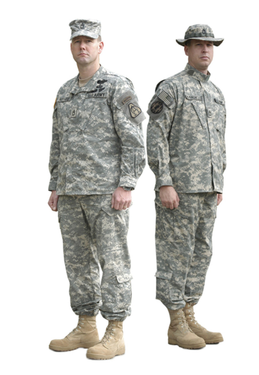 Two soldiers in 2005 wearing the Army Combat Uniform in the Universal Camouflage Pattern. The pattern — never popular with the Army — was officially retired on September 30, 2019.